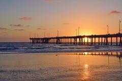 Puesta del sol de la playa de Venecia Foto de archivo libre de regalías