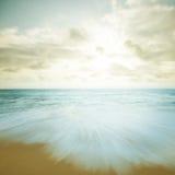 Puesta del sol de la playa del vintage imagen de archivo libre de regalías
