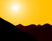 Puesta del sol de las montañas Foto de archivo libre de regalías