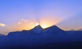 Puesta del sol de las montañas de Minya Konka Foto de archivo libre de regalías