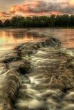 Puesta del sol de los rápidos del río Imagen de archivo libre de regalías
