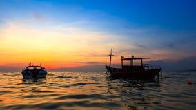 Puesta del sol de madera del barco Imagen de archivo libre de regalías