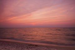 Puesta del sol de Michigan de lago con la playa fotos de archivo libres de regalías