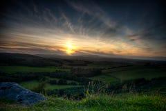 Puesta del sol de Northumberland fotos de archivo
