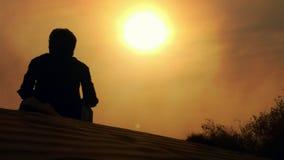 Puesta del sol de observación Fotos de archivo