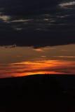 Puesta del sol de oro asombrosa Imagen de archivo libre de regalías