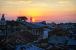 Puesta del sol de piedra de la ciudad Foto de archivo