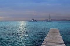 Puesta del sol de plata mágica del mar de Formentera de la turquesa Fotos de archivo