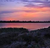 Puesta del sol de Ucrania en el mar de Azov Imagen de archivo libre de regalías