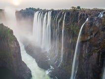 Puesta del sol de Victoria Falls, lado de Zambia Foto de archivo