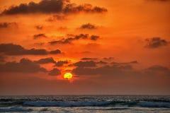 Puesta del sol debajo del mar Fotografía de archivo