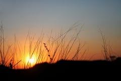 Puesta del sol dejada imagenes de archivo