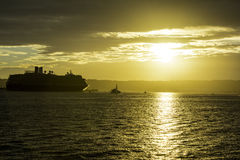 Puesta del sol del barco de cruceros Imagen de archivo libre de regalías