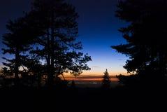 Puesta del sol del bosque Fotografía de archivo libre de regalías