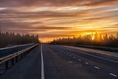 Puesta del sol del camino Foto de archivo