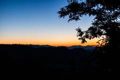 Puesta del sol del campo Foto de archivo libre de regalías