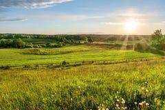 Puesta del sol del campo Fotos de archivo libres de regalías