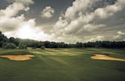 Puesta del sol del campo de golf Fotos de archivo libres de regalías