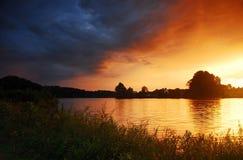 Puesta del sol del claro Foto de archivo libre de regalías