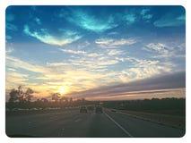 Puesta del sol del coche Fotos de archivo