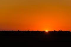 Puesta del sol del día de verano caliente Fotografía de archivo libre de regalías