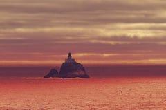 Puesta del sol del faro Imagen de archivo libre de regalías