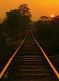 Puesta del sol del ferrocarril de Birmania Fotografía de archivo