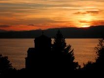Puesta del sol del lago monastery Imagen de archivo