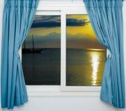 Puesta del sol del mar de la ventana Imagen de archivo