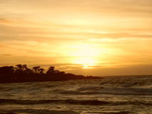 Puesta del sol del océano de Pebble Beach Fotos de archivo libres de regalías