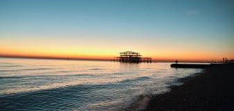Puesta del sol del oeste del embarcadero Foto de archivo libre de regalías
