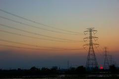 Puesta del sol del poste de la electricidad Imágenes de archivo libres de regalías