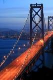Puesta del sol del puente de la bahía Imagenes de archivo