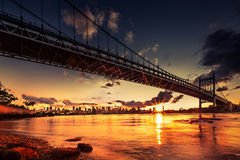 Puesta del sol del puente de Triboro Imagenes de archivo