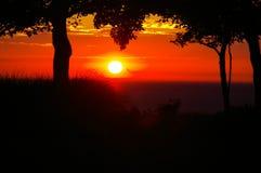 Puesta del sol del rojo del lago Michigan Imágenes de archivo libres de regalías