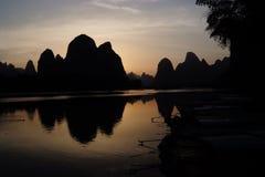 Puesta del sol del silbido de bala de Xing imagenes de archivo