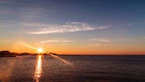 Puesta del sol delante de la ciudad de Trieste Imagen de archivo libre de regalías