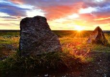 Puesta del sol delante de Seljalandsfoss Imagen de archivo libre de regalías