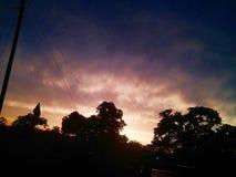 Puesta del sol después de una jornada completa de la lluvia Fotografía de archivo libre de regalías