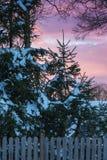 Puesta del sol después de una tormenta de la nieve Foto de archivo libre de regalías