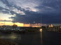 Puesta del sol detrás del 🌦 de la lluvia foto de archivo libre de regalías