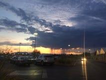 Puesta del sol detrás de la lluvia fotografía de archivo