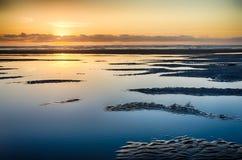 Puesta del sol Devon de la playa Imagen de archivo libre de regalías