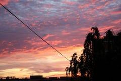 Puesta del sol Diversos colores de la puesta del sol Fotografía de archivo