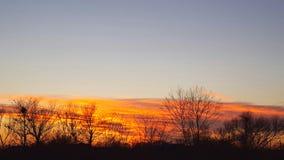 Puesta del sol el invierno imagenes de archivo