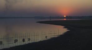 Puesta del sol en Amarapura Foto de archivo