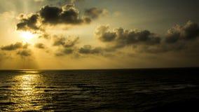 Puesta del sol en Apollonia Beach Imágenes de archivo libres de regalías