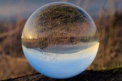 Puesta del sol en bola de cristal Imágenes de archivo libres de regalías