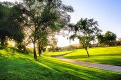 Puesta del sol en campo de golf Foto de archivo