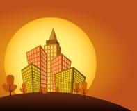 Puesta del sol en ciudad anaranjada Foto de archivo libre de regalías